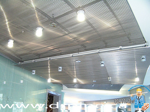 fire-sprinklers-on-the-suspende-decorative-stainless-still-ceiling